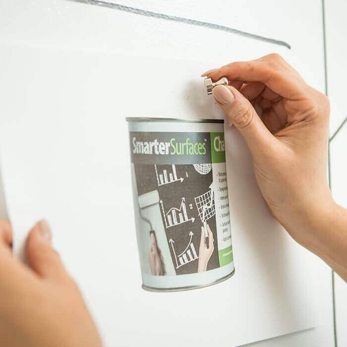 photo being attached on a magnetic wall created with smarter surfaces