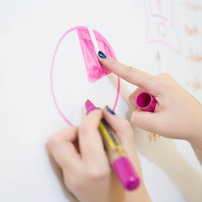 Person erasing marker on Smart Whiteboard Wallpaper