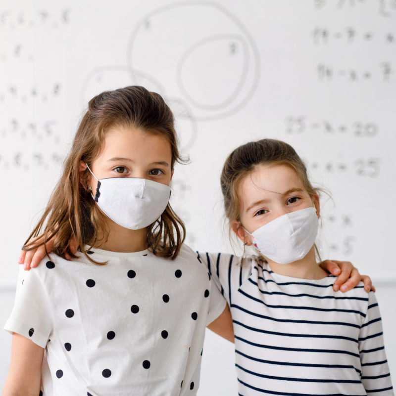 two-children-standing-infront-of-Smart‌ -Antimicrobial-whiteboard-paint